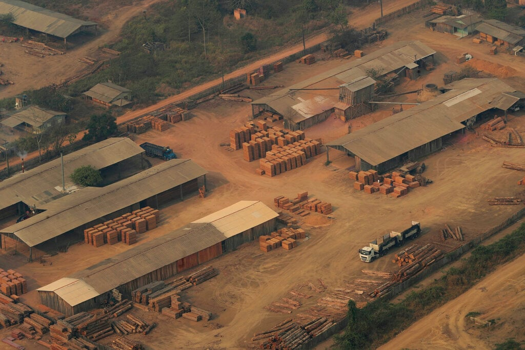 A lumber yard is seen from the air, in the city of Jaci Parana, Rondonia state, Brazil, Saturday, Aug. 24, 2019. (AP Photo/Eraldo Peres)