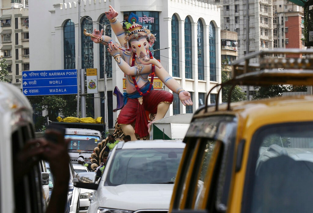 Devotees transport an idol of Hindu god Ganesha to a worship venue ahead of the Ganesh Chaturti festival in Mumbai, India, Sunday, Aug. 25, 2019. (AP Photo/Rajanish Kakade)