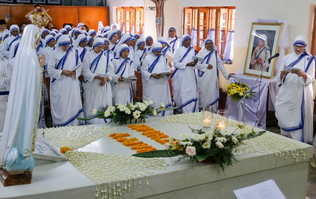 Sister Mary Prema Pierick, right, Superior General of the Missionaries of Charity, the order founded by Mother Teresa, and other nuns pray by her tomb on her birth anniversary in Kolkata, India, Monday, Aug. 26, 2019. (AP Photo/Bikas Das)