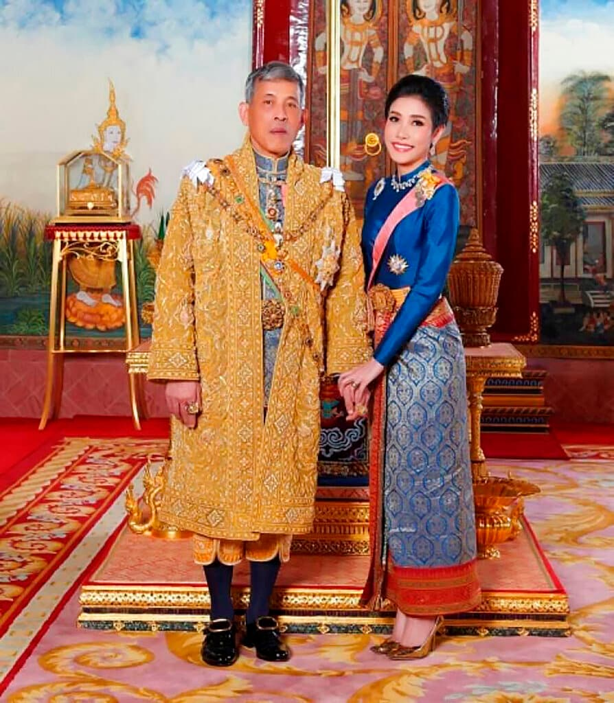 This undated photo posted Monday, Aug. 26, 2019, on the Thailand Royal Office website shows King Maha Vajiralongkorn, left, with Major General Sineenatra Wongvajirabhakdi, the royal noble consort. She was bestowed the title of Chao Khun Phra Sineenatra Bilasakalayani by King Maha Vajiralongkorn during a ceremony in late July. In May the king named another woman Suthida Vajiralongkorn Na Ayudhya as the queen of Thailand. (Thailand Royal Office via AP)