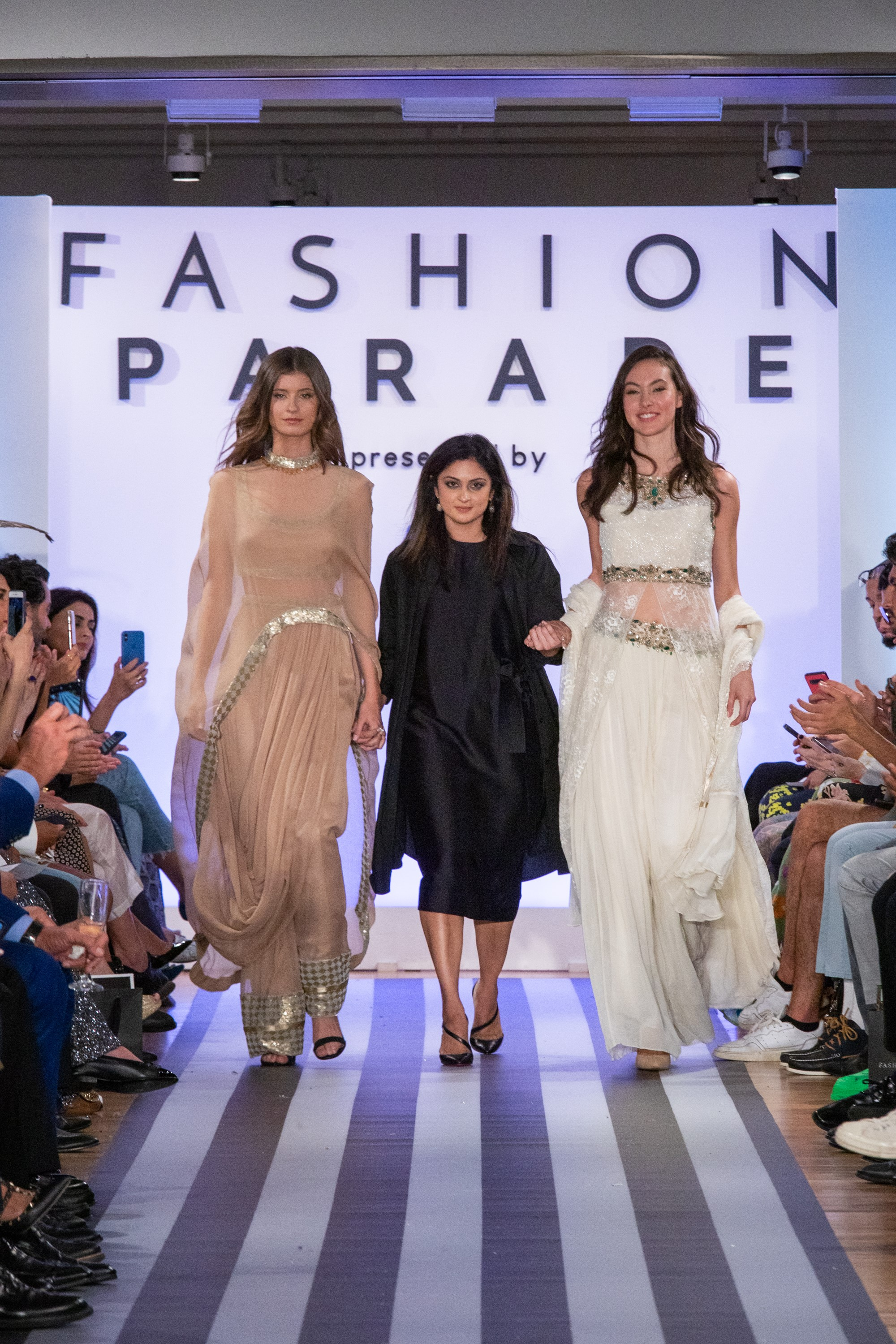 Designer Fazia Samee with models showing her collection.