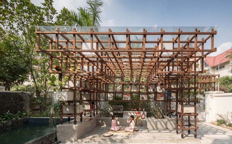 #15. VAC Library, Hanoi, Vietnam: Part library, part urban farm, part playground, this farming architects project in Hanoi is geared toward teaching kids about ecosystems and agriculture. The VAC Library's climbable wooden structure contains both a small collection of books and a mini-ecosystem comprising a garden, a fish pond and a chicken coop — all connected through aquaponics.