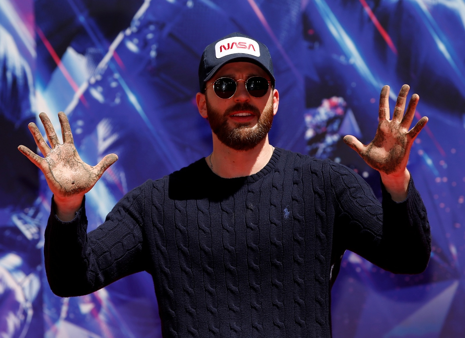 #8. Chris Evans: Net Earnings: $43.5 million. Best known for playing Captain America, Evans' hefty 'Avengers: Endgame' salary and backend points land him on the Celebrity 100 for the first time. Evans keeps busy when he's not saving the universe, with roles in 'Knives Out' and 'The Red Sea Diving Report.' He is returning to the small screen, where he got his start, with upcoming Apple TV+ series 'Defending Jacob.' (Image: Reuters)