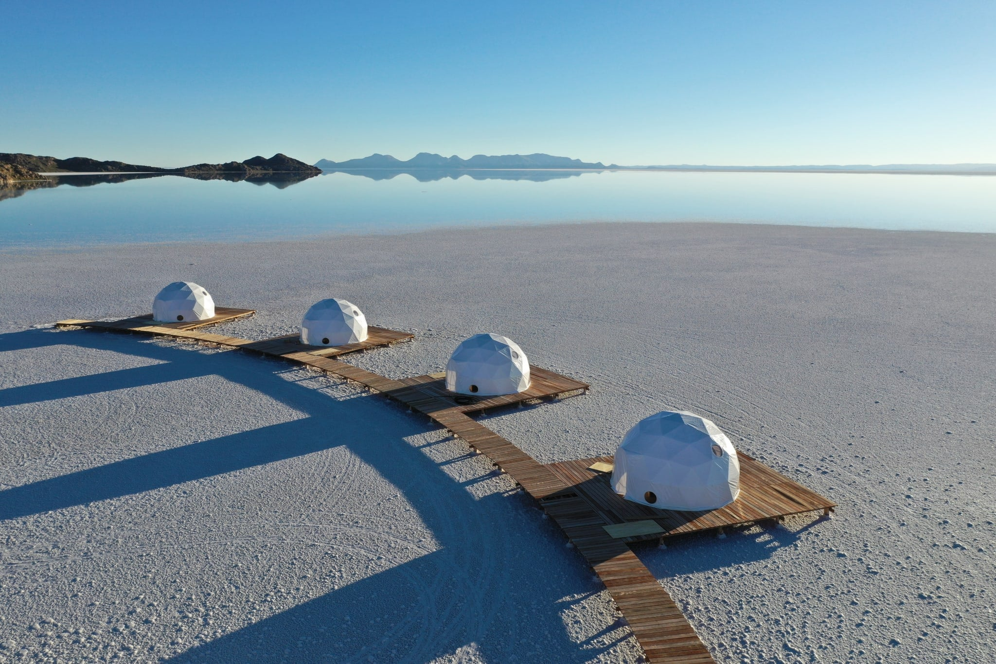 #5. Kachi Lodge, Uyuni Salt Flats, Bolivia: Until we start sending commercial flights to the moon, the Kachi Lodge on Bolivia's Uyuni Salt Flats might be the most otherworldly vacation you can take. Opened in May at the foot of a volcano, Kachi (a two-night stay starts at $1,980 per person) is the first permanent ­accommodation of its kind on the world's largest salt flat, and its cluster of geo­desic domes resembles an isolated space station. (Image: Stock)