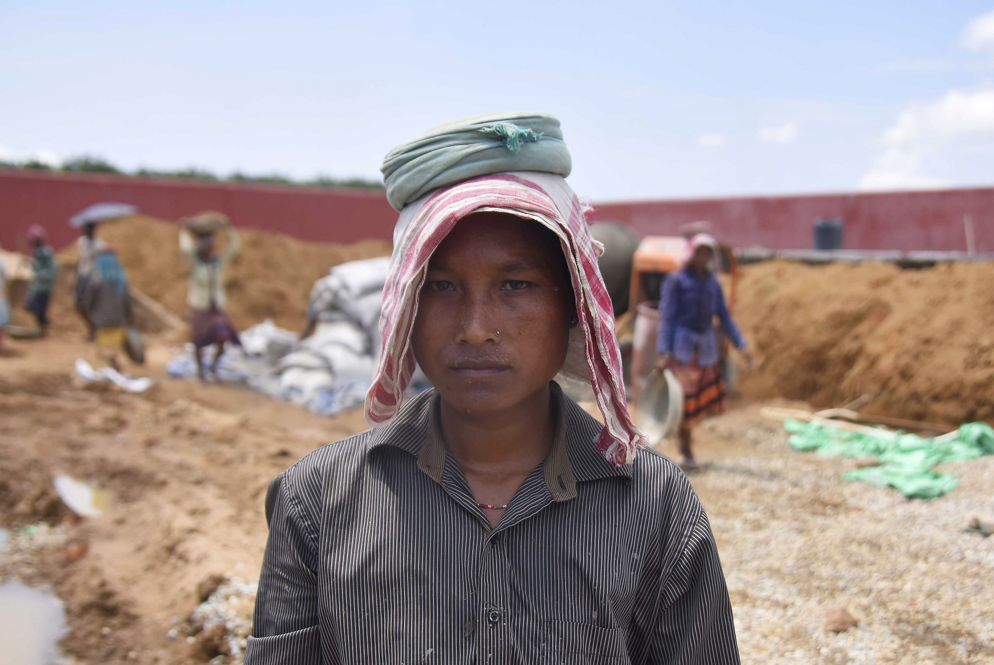 Shefali Hajong, a labourer whose name is excluded from the final list of the National Register of Citizens (NRC), poses for a picture at the site of an under-construction detention centre for illegal immigrants at a village in Goalpara district in the northeastern state of Assam, India, September 1, 2019. REUTERS/Anuwar Hazarika