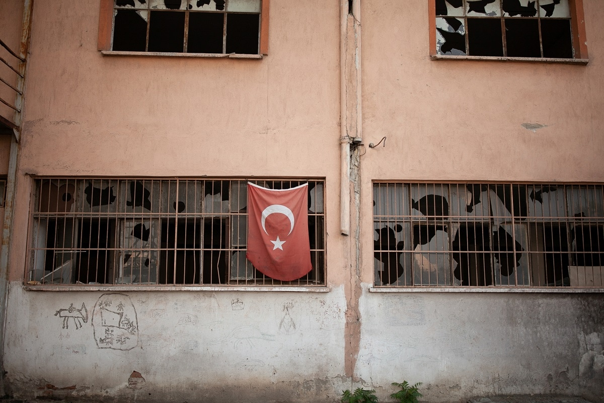 A Turkish flag hangs from the window of an abandoned factory in Hilal, one of the poorest areas in Izmir. REUTERS/Ekaterina Anchevskaya/Files