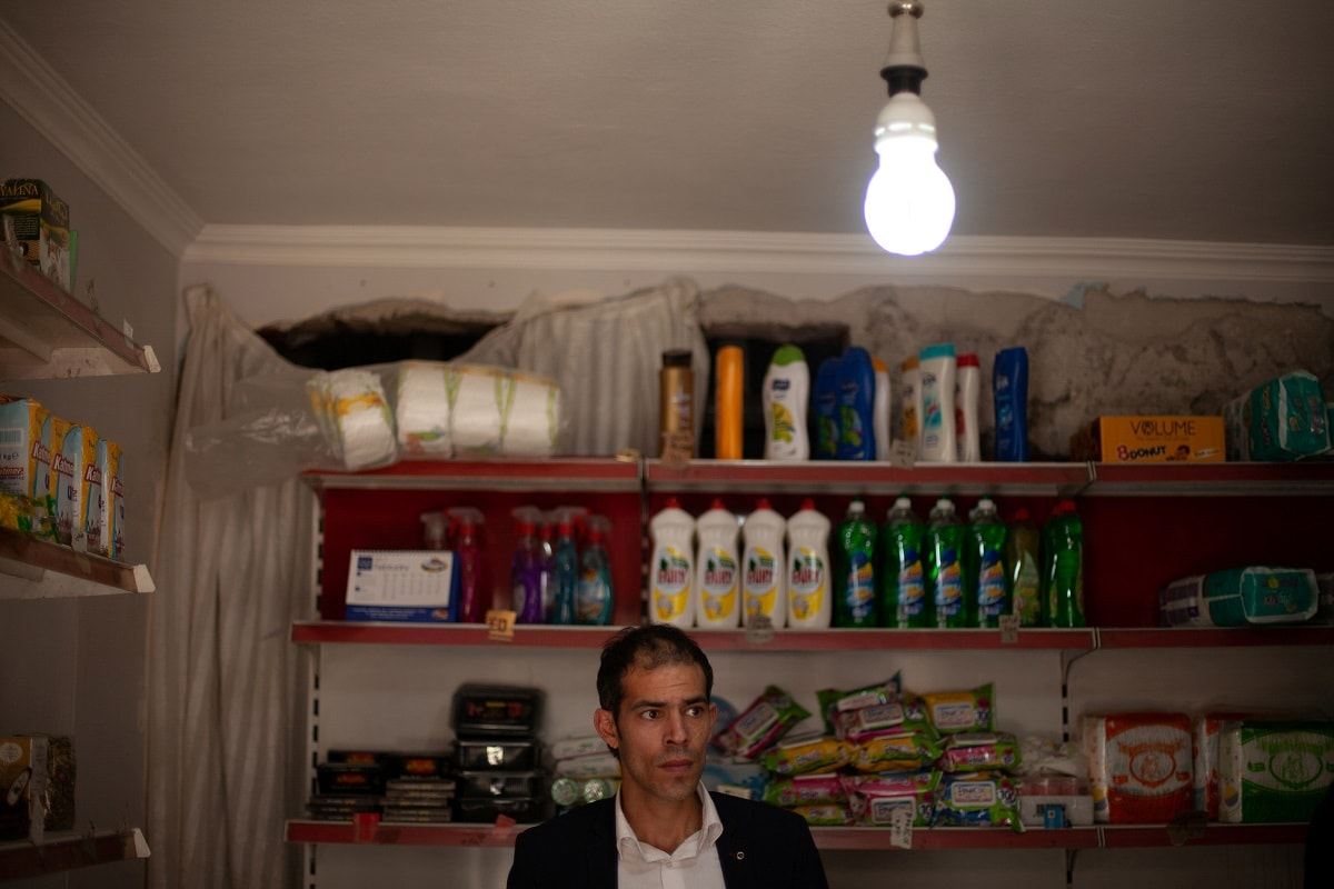 A Syrian man poses for a photograph in a shop run by his family in Izmir. REUTERS/Ekaterina Anchevskaya/Files
