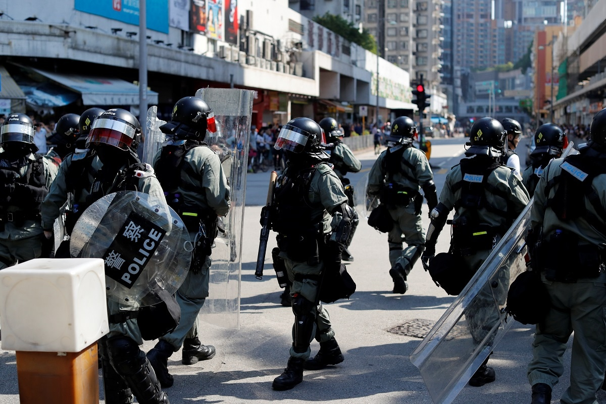Riot police stand guard as anti-government protesters gather in Tuen Mun, Hong Kong. REUTERS/Jorge Silva