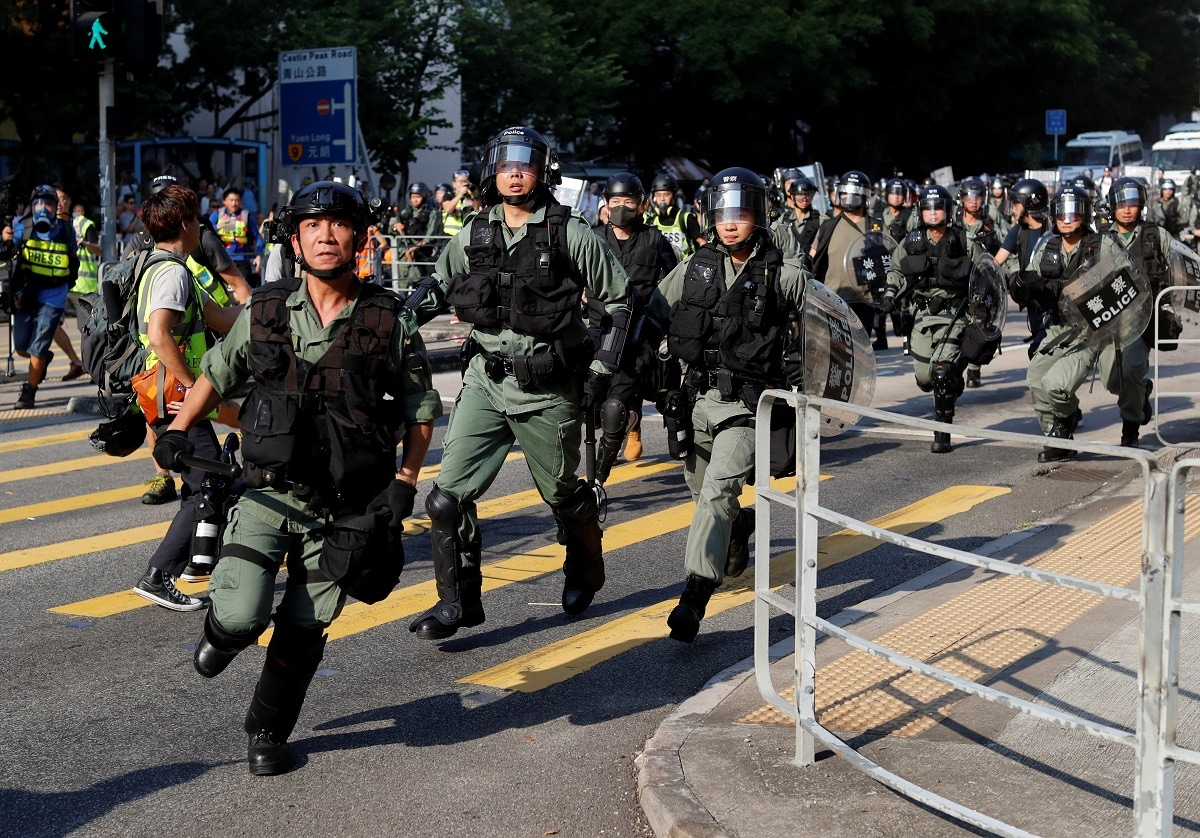 Riot police advance during an anti-government march in Tuen Mun. REUTERS/Jorge Silva