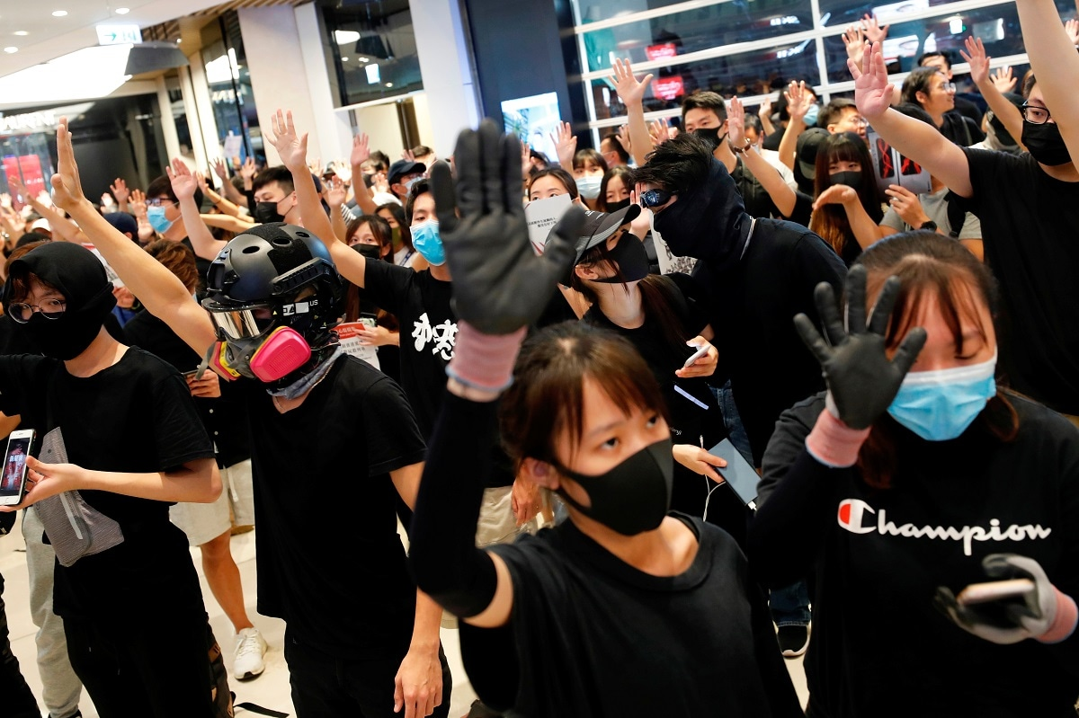 Anti-government protesters gather during a sit-in at Yoho mall, at Yuen Long MTR station, in Hong Kong. REUTERS/Tyrone Siu