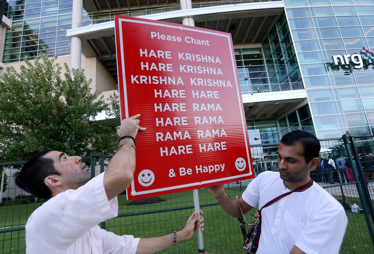 Members of the Hare Krishna movement set up a sign before a