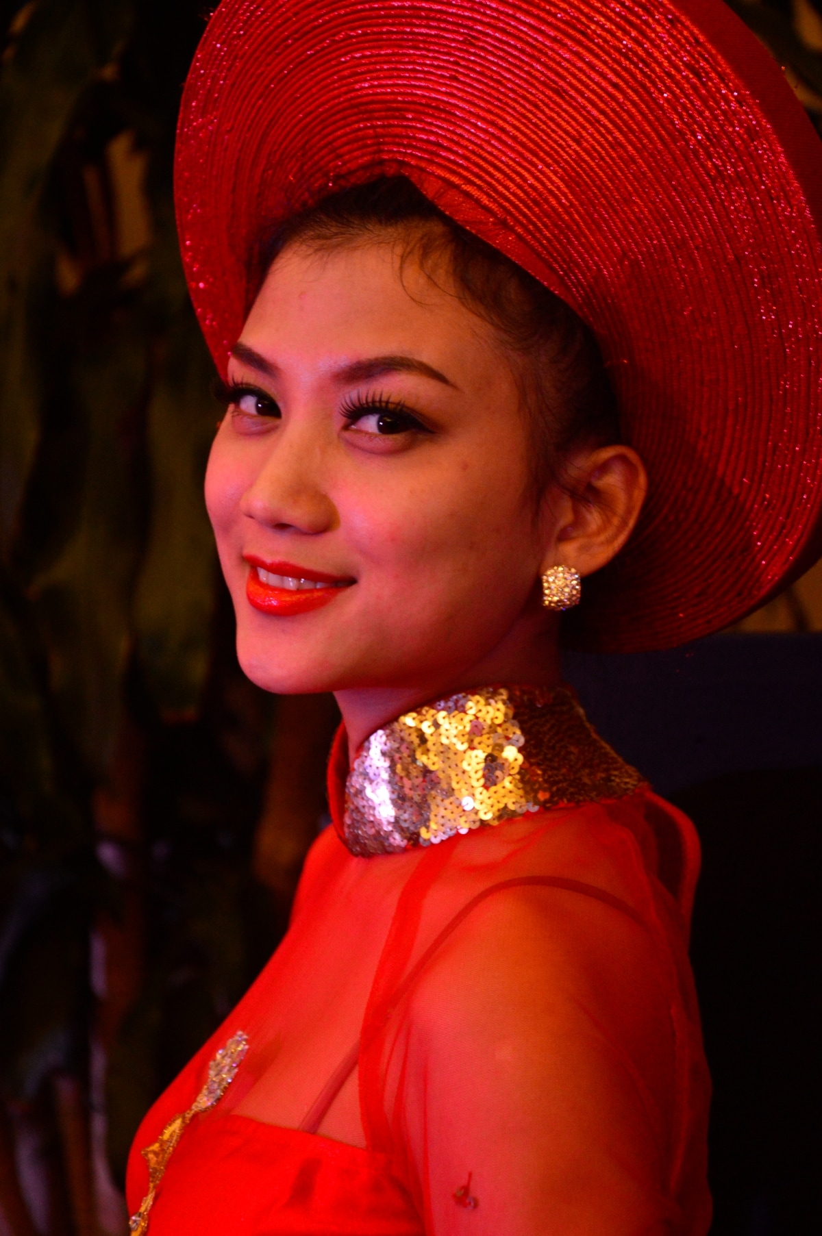 A Vietnamese girl in her traditional dress and hat in Hanoi, Vietnam.