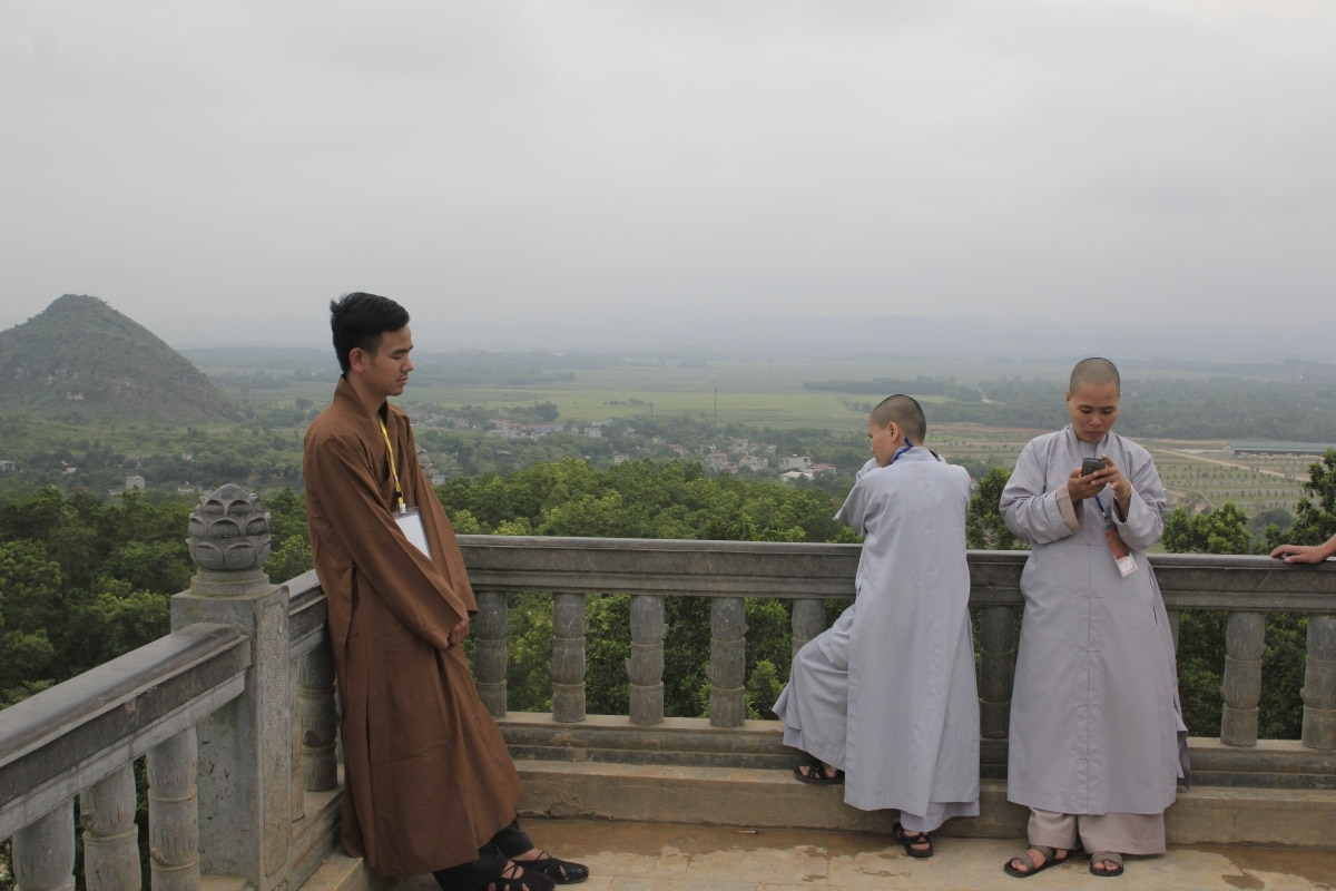 Vietnamese Buddhist monks in their typical clothing in Hanoi, Vietnam.