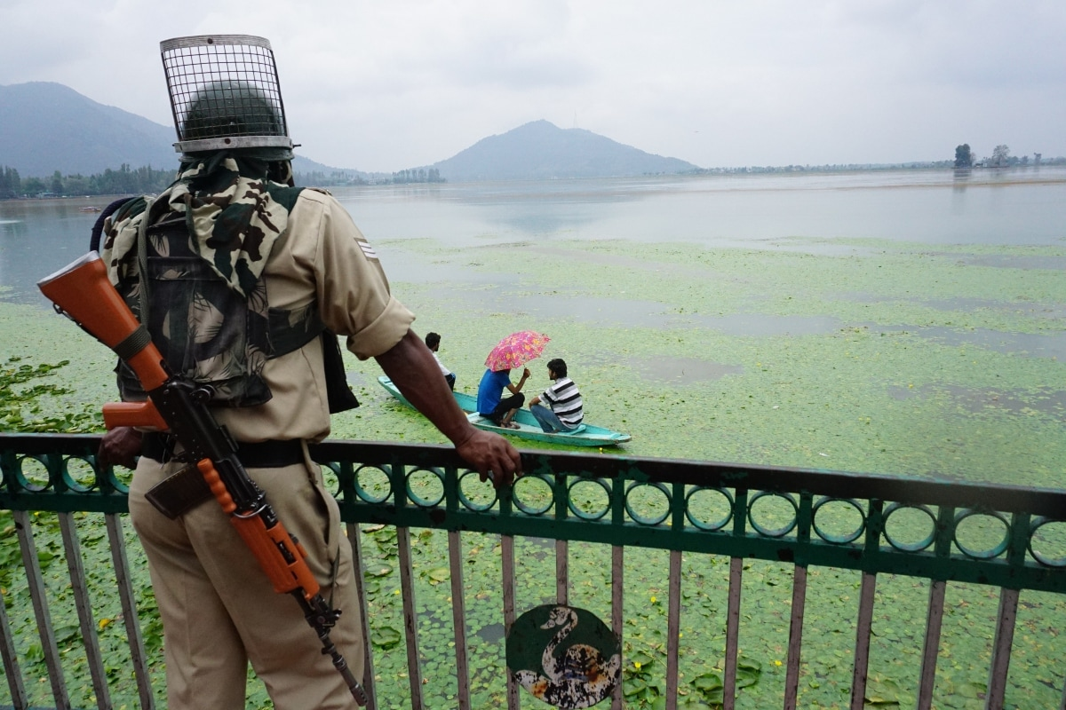 A paramilitary jawan guarding Dal Lake in Srinagar, Jammu and Kashmir.