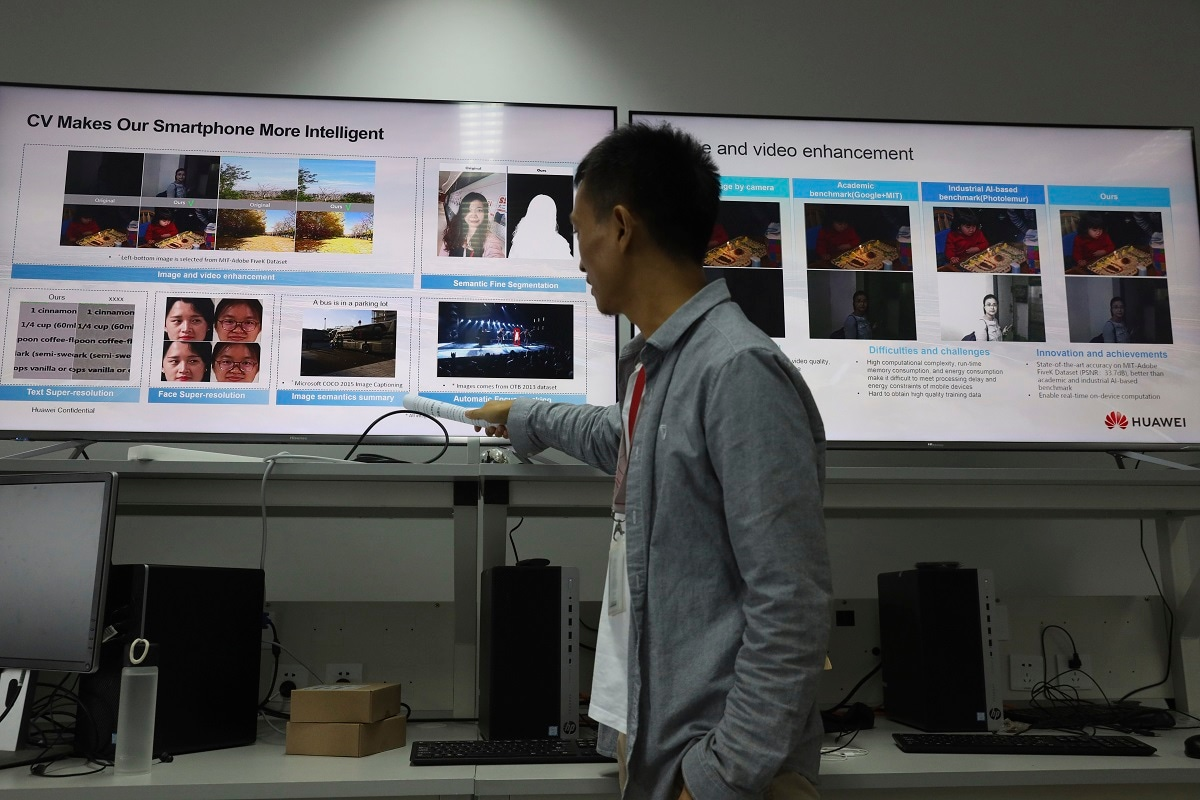 A Huawei employee introduces the work done at a lab specializing in the use of Artificial Intelligence at the Huawei Campus in Shenzhen. (AP Photo/Ng Han Guan)