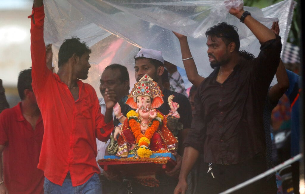 Indian Hindu devotees carry an idol of elephant-headed Hindu god Ganesha for immersing it in the Arabian Sea on the second day of the ten-day long Ganesh Chaturthi festival in Mumbai, India, Tuesday, September 3, 2019. The festival is a celebration of the birth of Ganesha, the Hindu god of wisdom, prosperity and good fortune. (AP Photo/Rajanish Kakade)