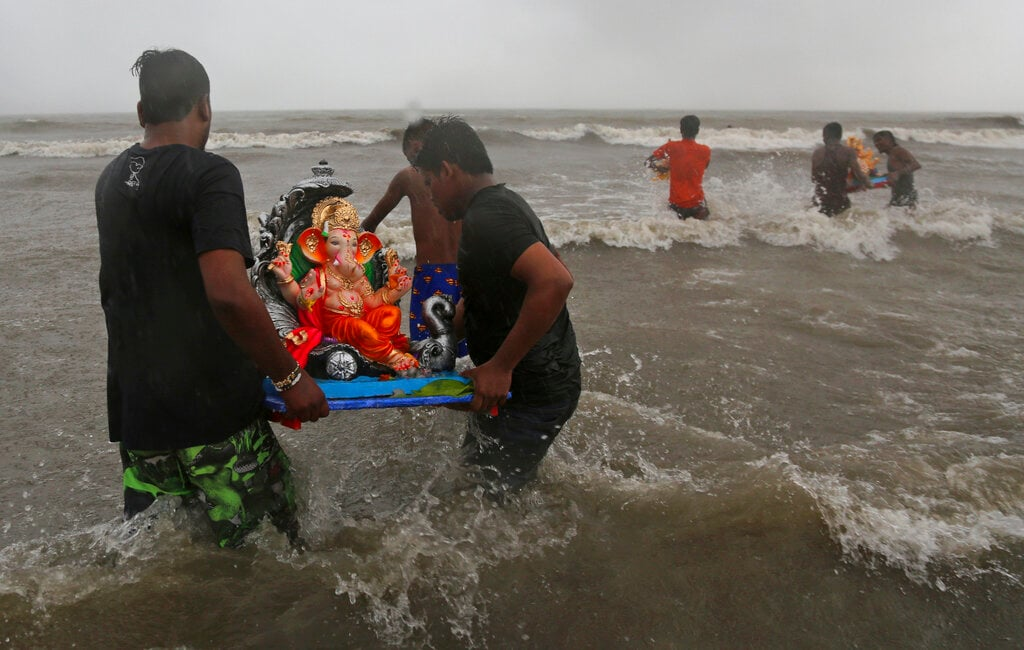 Devotees carry an idol of elephant-headed Hindu god Ganesha for immersing it in the Arabian Sea on the second day of the ten-day long Ganesh Chaturthi festival in Mumbai, India, Tuesday, September 3, 2019. The festival is a celebration of the birth of Ganesha, the Hindu god of wisdom, prosperity and good fortune. (AP Photo/Rafiq Maqbool)