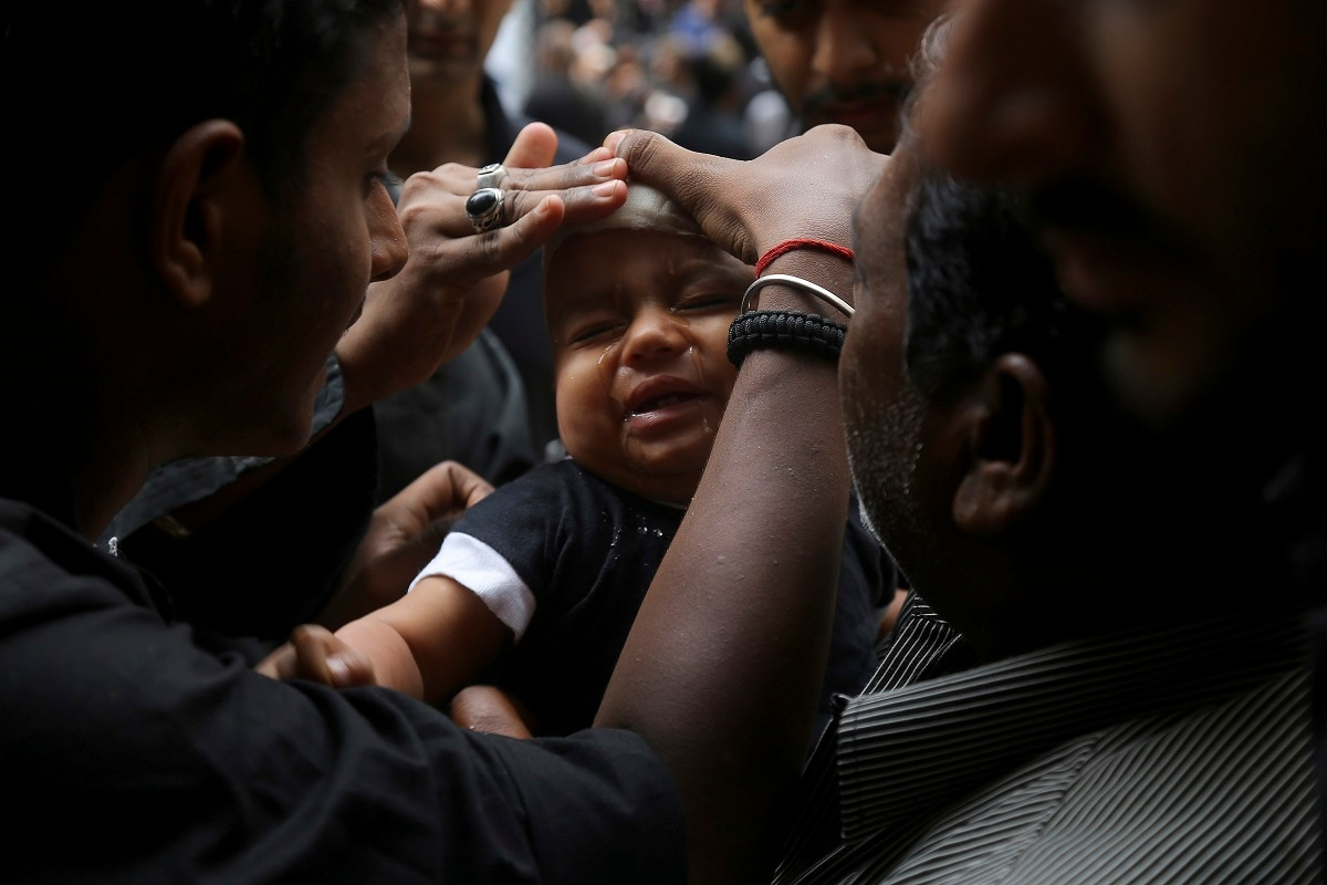 Shiite Muslim child cries after he was given a cut on the forehead during an Ashoura procession in Hyderabad. Ashoura falls on the 10th day of Muharram, the first month of the Islamic calendar, when Shiites mark the death of Hussein, the grandson of the Prophet Muhammad, at the Battle of Karbala in present-day Iraq in the 7th century. (AP Photo/Mahesh Kumar A., File)
