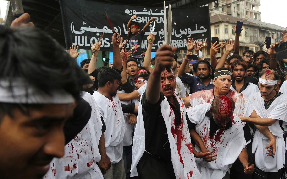 Shiite Muslims flagellate themselves during a procession to mark Ashoura in Mumbai.  (AP Photo/Rafiq Maqbool, File)