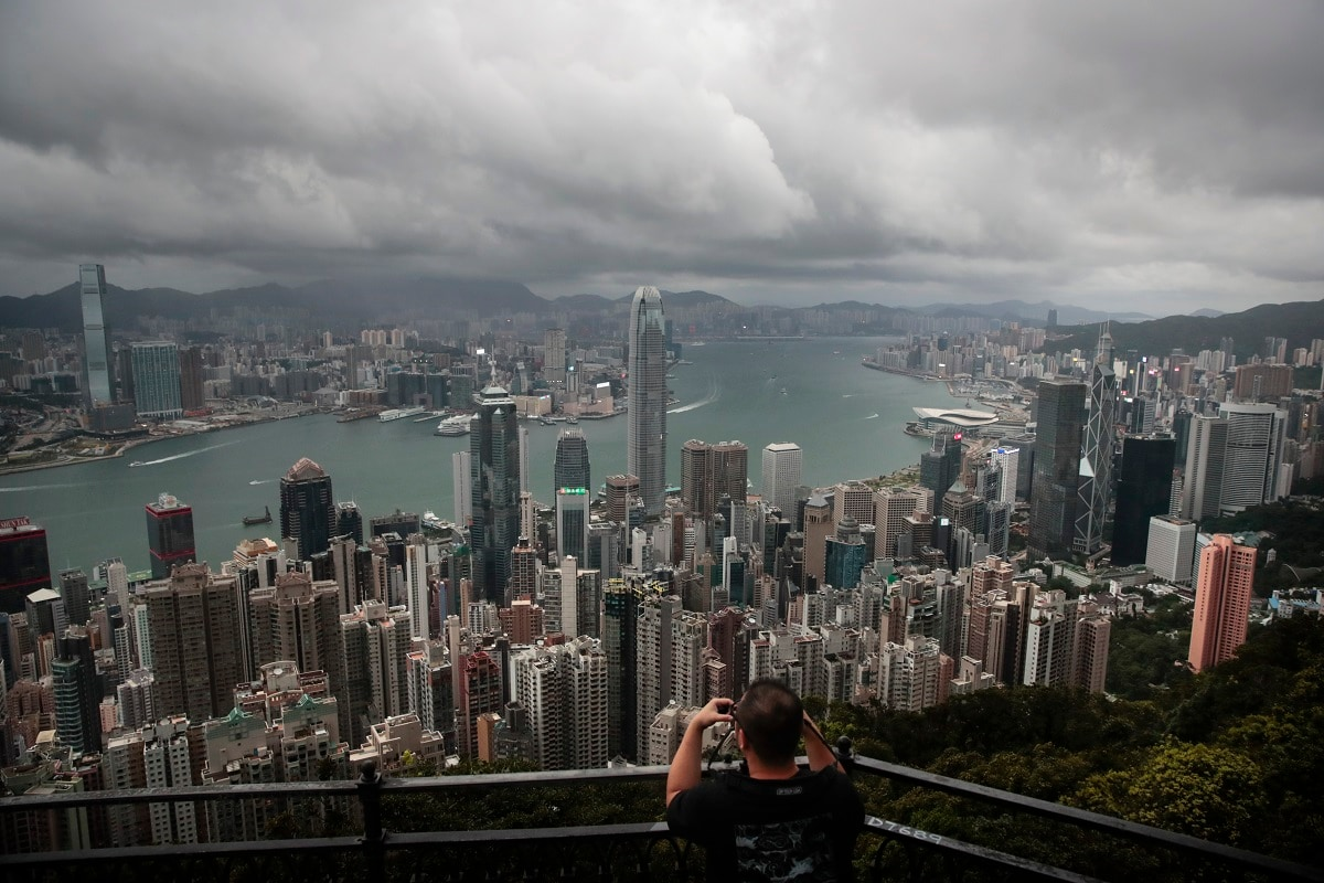 A man sets up his camera in the Victoria Peak area to photograph Hong Kong's skyline.  (AP Photo/Jae C. Hong)