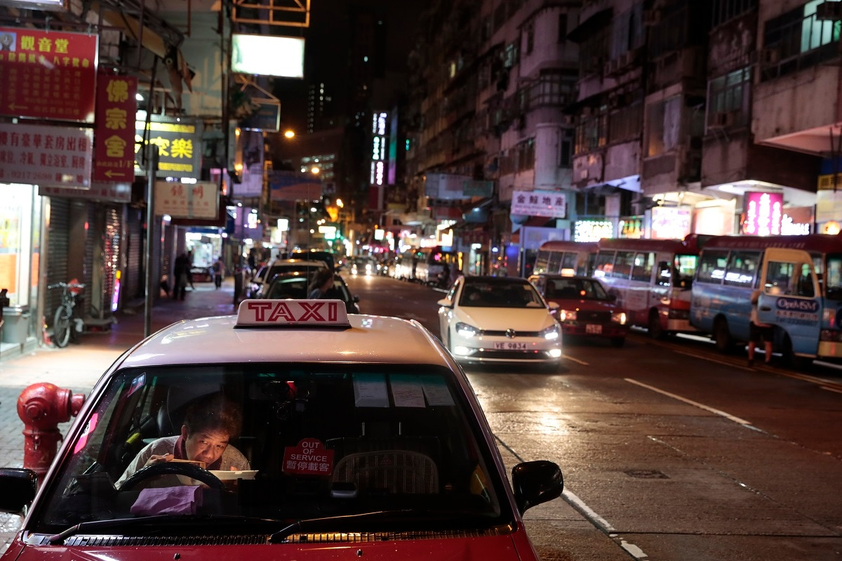 A taxi driver eats his late dinner in his car near the Temple Street Night Market in Hong Kong. (AP Photo/Jae C. Hong)