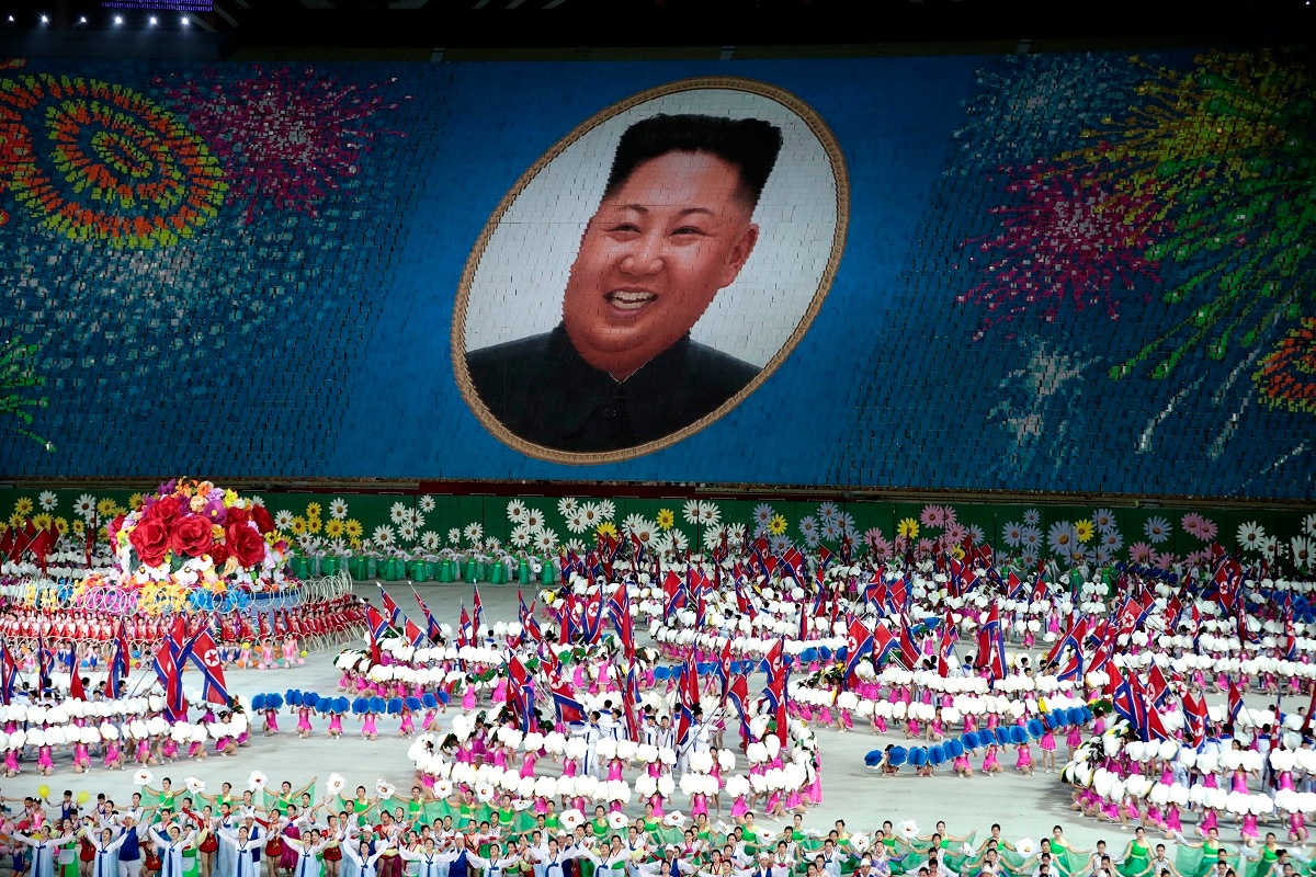 Performers hold up cards to form a portrait of North Korean leader Kim Jong Un during a mass games performance titled