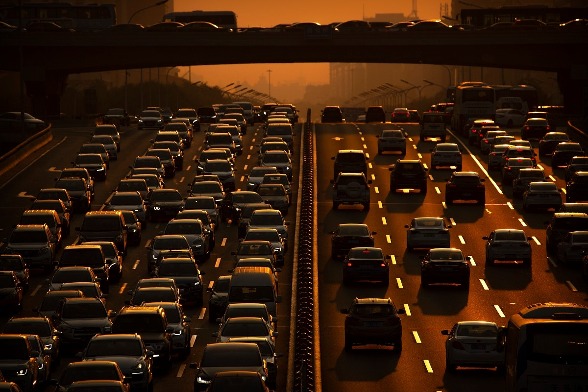 Commuters make their way along an expressway during rush hour in Beijing. According to Chinese state media, the average concentration of PM2.5 fine air pollutants in Beijing in August was at the lowest level ever recorded for that month. (AP Photo/Mark Schiefelbein, File)