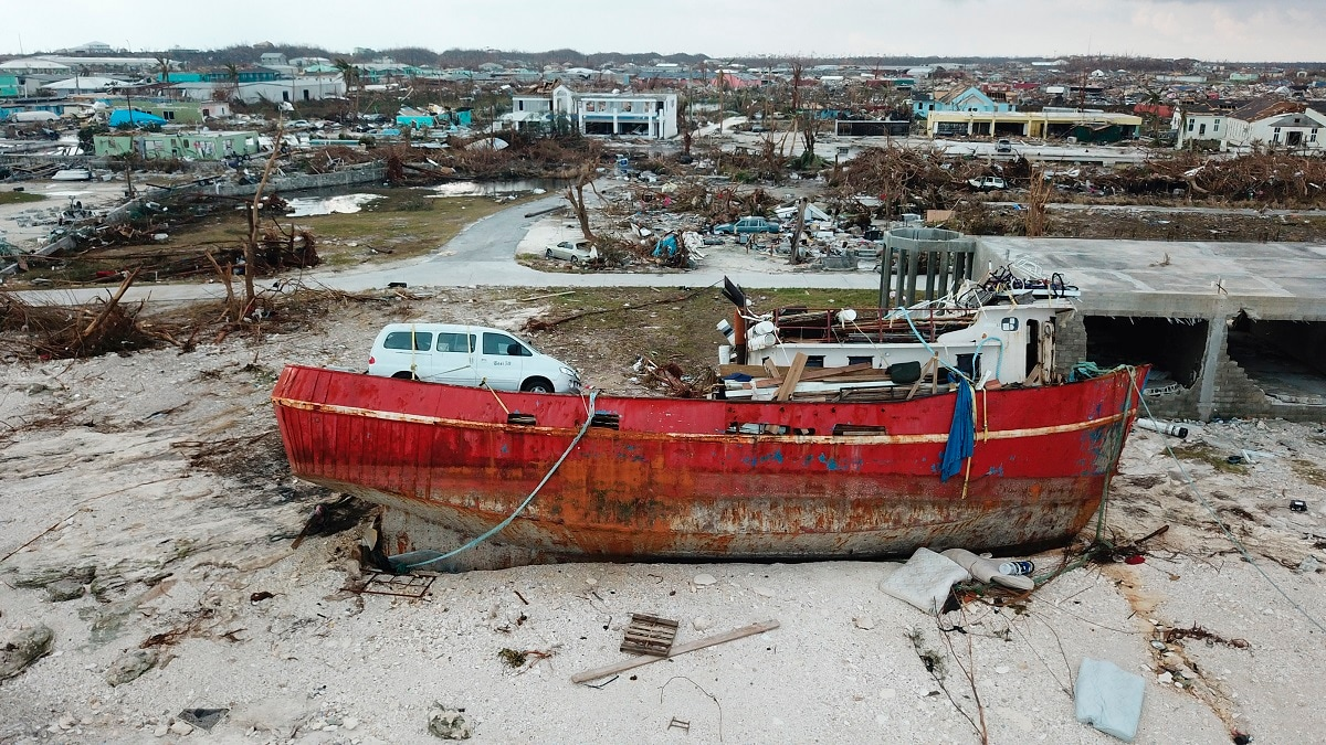 A boat sits grounded in the aftermath of Hurricane Dorian, in Marsh Harbor, Abaco Island, Bahamas. The Bahamian health ministry said helicopters and boats are on the way to help people in affected areas, though officials warned of delays because of severe flooding and limited access. (AP Photo/Gonzalo Gaudenzi)