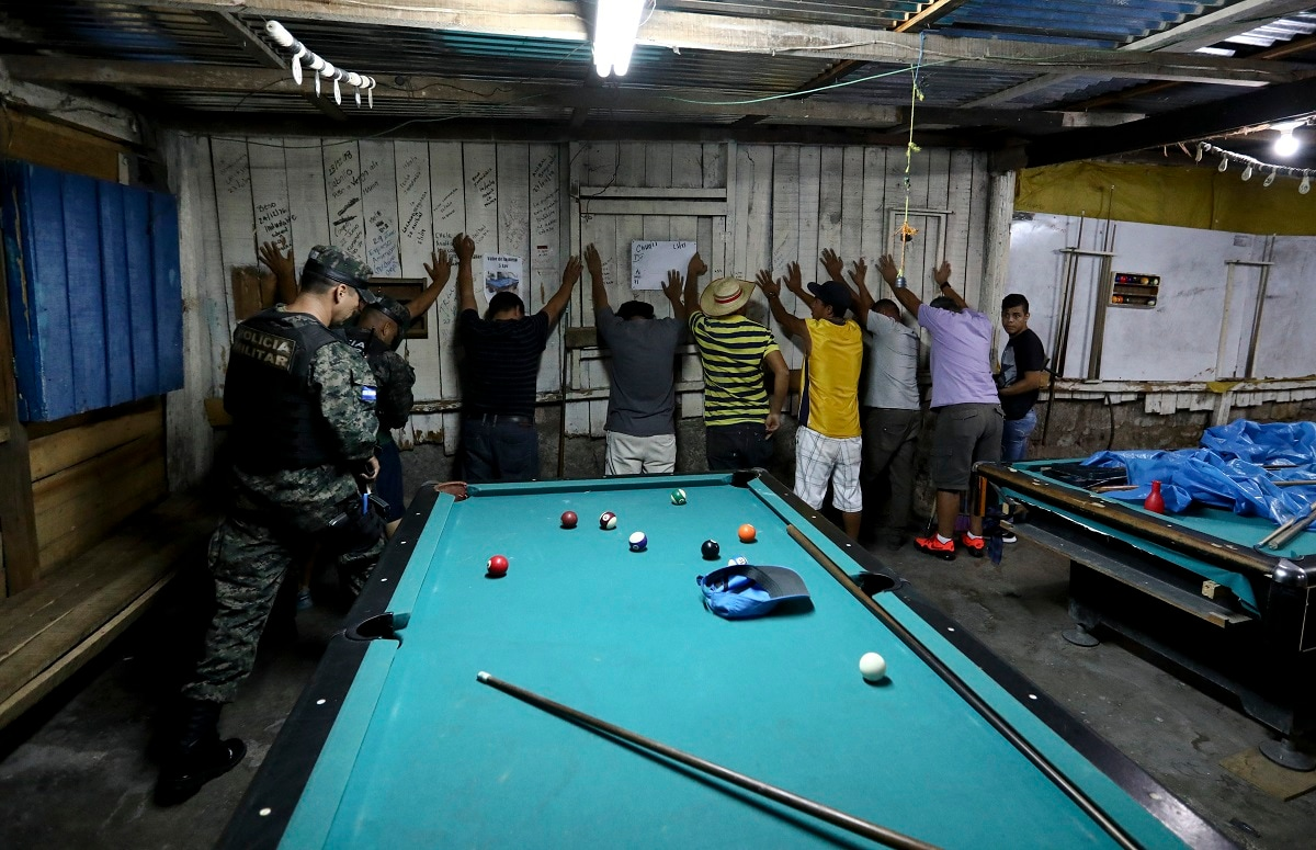 Soldiers enter a pool hall during their routine patrol in Tegucigalpa, Honduras. Ironically, the extradition of drug capos to the US under Honduran President Juan Orlando Hernández could have helped build the case against his own brother, in which he is now implicated. (AP Photo/Eduardo Verdugo)