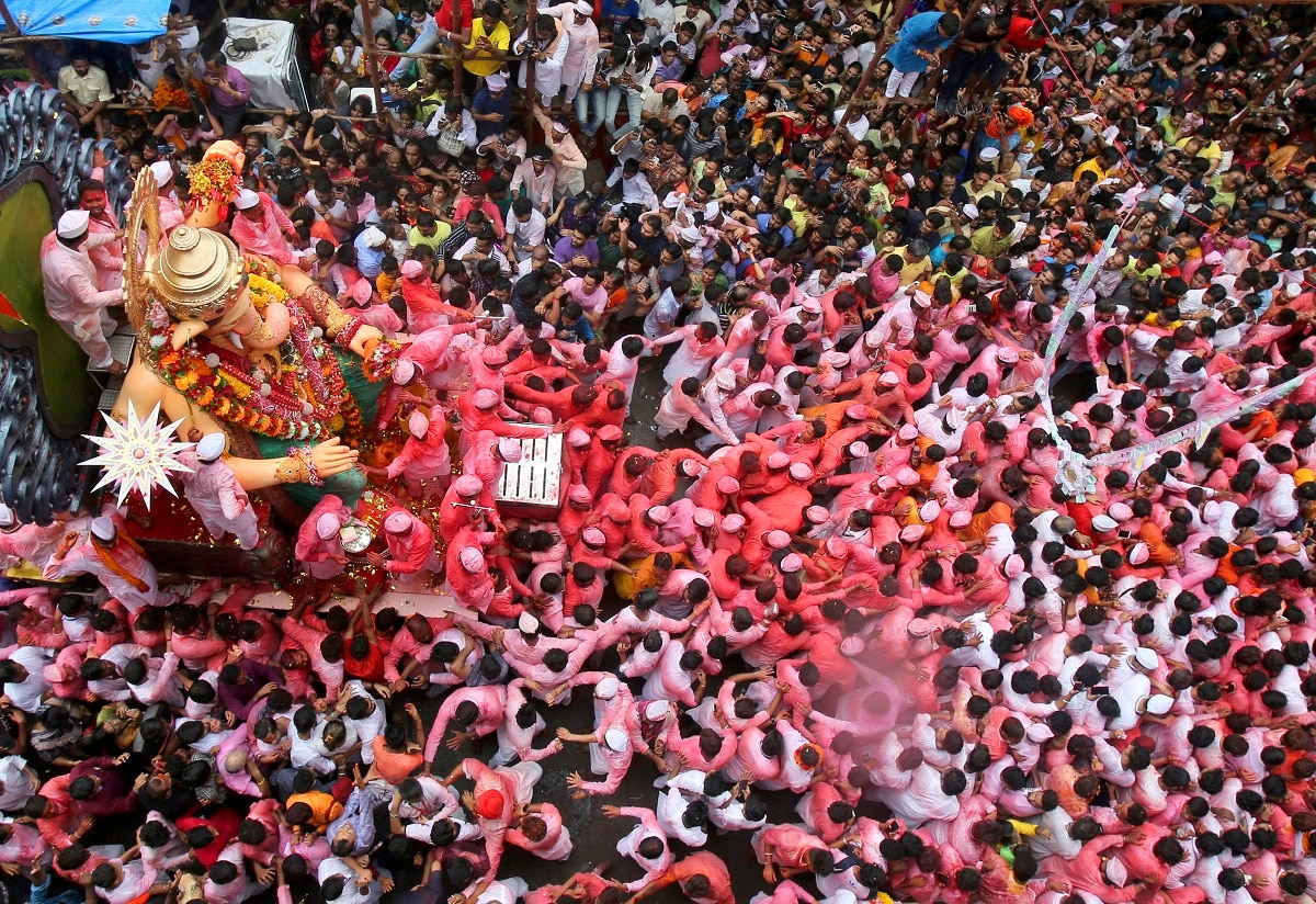 Devotees participate in a procession with a large statue of elephant-headed Hindu god Ganesh in Mumbai, India. Every year millions of devout Hindus immerse Ganesh idols into oceans and rivers in the ten-day-long Ganesh Chaturthi festival that celebrates the birth of Ganesh. (AP Photo/Rafiq Maqbool, File)