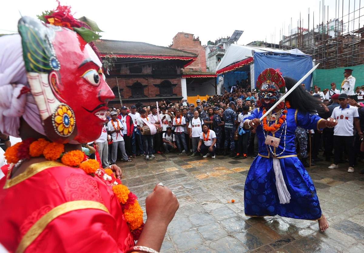 Masked dancers perform a traditional dance during Indra Jatra festival, an eight-day festival that honours Indra, the Hindu god of rain, in Kathmandu, Nepal. (AP Photo/Niranjan Shrestha)