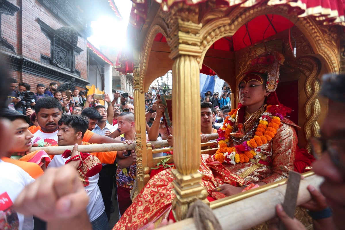 Devotees carry the chariot of living god Bhairabh during Indra Jatra festival. (AP Photo/Niranjan Shrestha)
