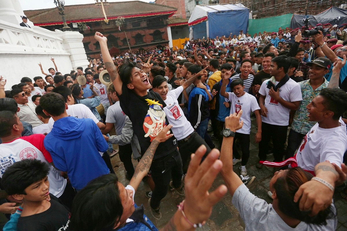 Devotees dance during Indra Jatra festival, an eight-day festival that honours Indra. (AP Photo/Niranjan Shrestha)