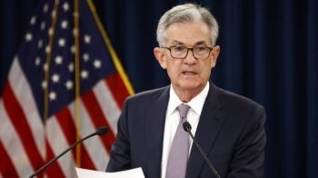 US Fed cuts interest rates, signals holding pattern for now