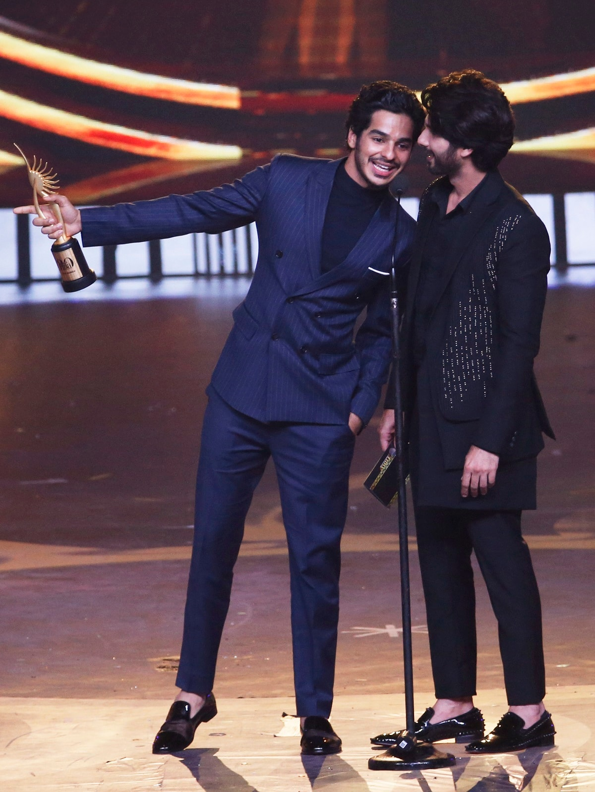 Bollywood actor Ishaan Khatter, left, speaks with his half-brother Shahid Kapoor after he receives the award for Best Debut male actor role during the 20th International Indian Film Academy (IIFA) awards ceremony. (AP Photo/Rafiq Maqbool)