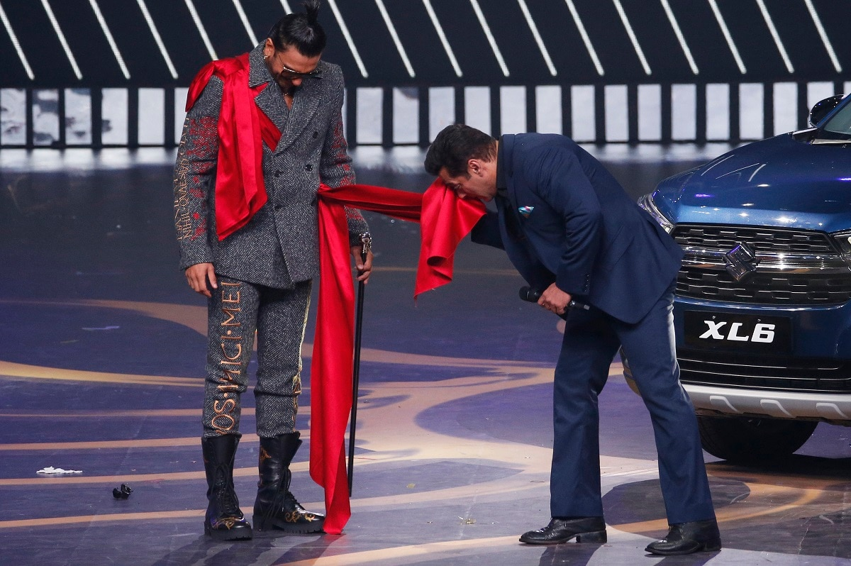 Bollywood actors Salman Khan, right, interacts with Ranveer Singh on stage during the 20th International Indian Film Academy (IIFA) awards ceremony. (AP Photo/Rafiq Maqbool)