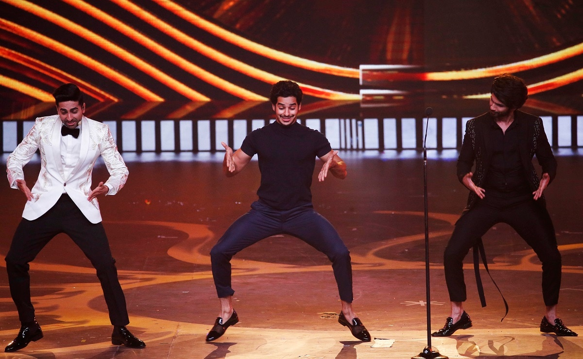 Bollywood actors Ayushmann Khurrana, left, along with Ishan Khattar, center, and Shahid Kapoor perform during the 20th International Indian Film Academy (IIFA) awards ceremony. (AP Photo/Rafiq Maqbool)