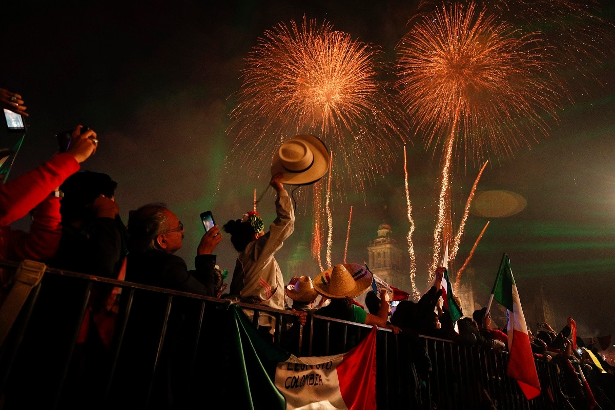 Revelers celebrate as fireworks explode over the Metropolitan Cathedral after President Andres Manuel Lopez Obrador gave the annual independence shout from the balcony of the National Palace to kick off Independence Day celebrations in Mexico City. Every year the Mexican president marks the
