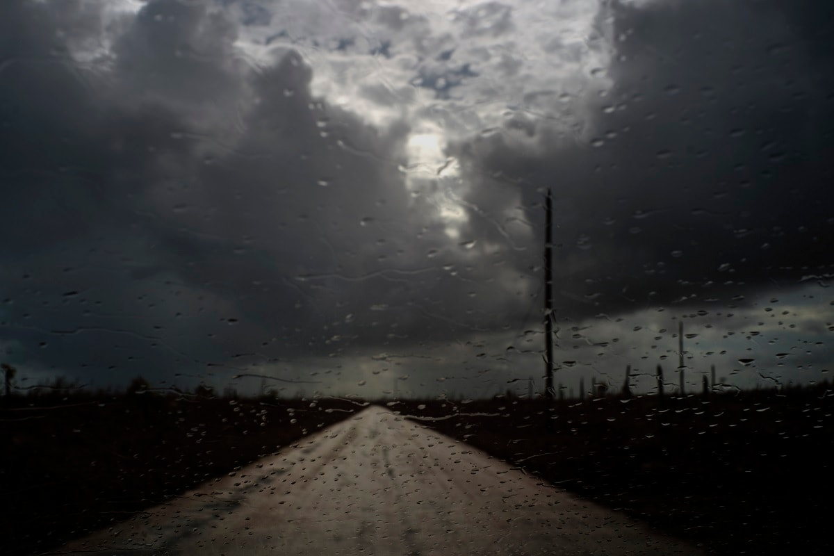Raindrops cover a car's window shield prior to the arrival of a new tropical depression, that turned into Tropical Storm Humberto, in the aftermath of Hurricane Dorian en route to Mclean's Town, Grand Bahama, Bahamas. Humberto narrowly missed the island over the weekend. (AP Photo/Ramon Espinosa)