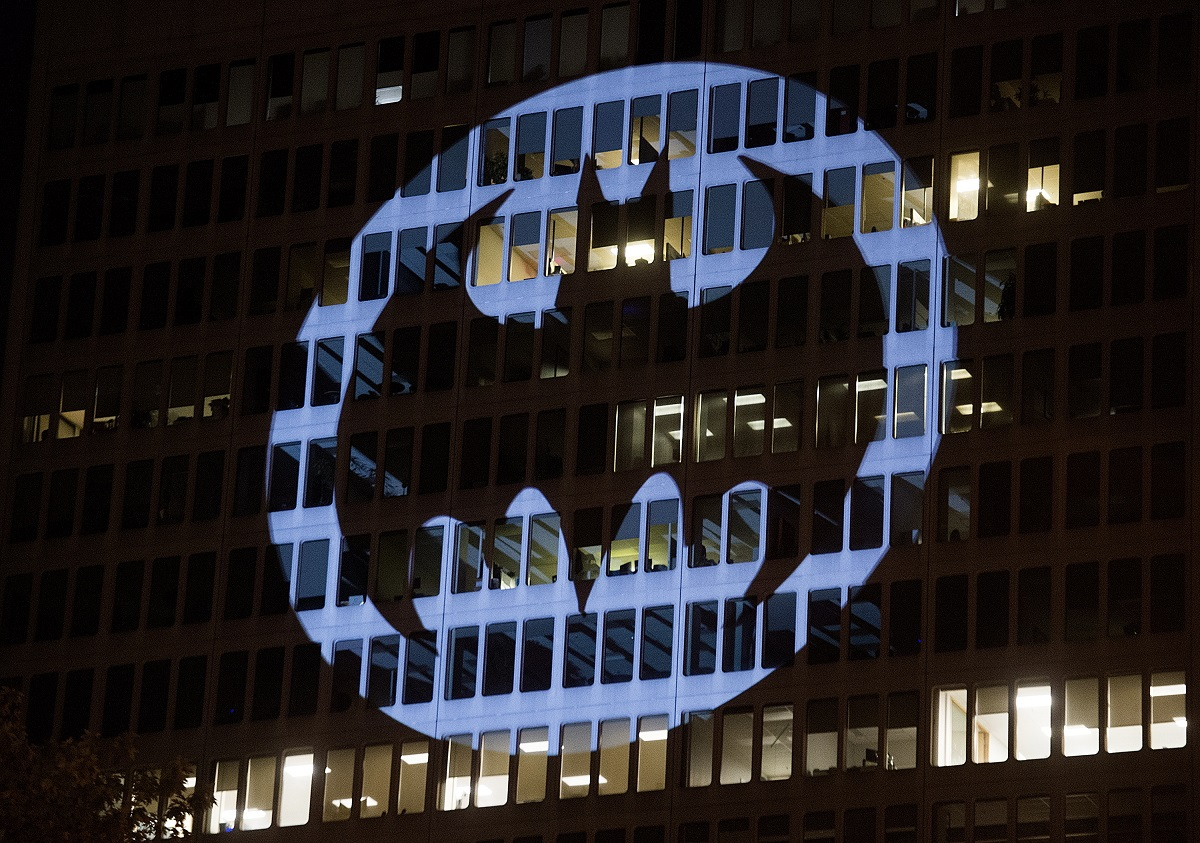 The Batman signal is projected onto a building to celebrate Batman Day in Montreal. The night sky all over the world is lighting up Saturday with an illumination of the famed bat insignia to mark a special anniversary for Batman. DC Comics is carrying off a celebration of Batman Day to mark the 80th anniversary of the appearance of crimefighter Bruce Wayne and his masked hidden identity. (Graham Hughes/The Canadian Press via AP)