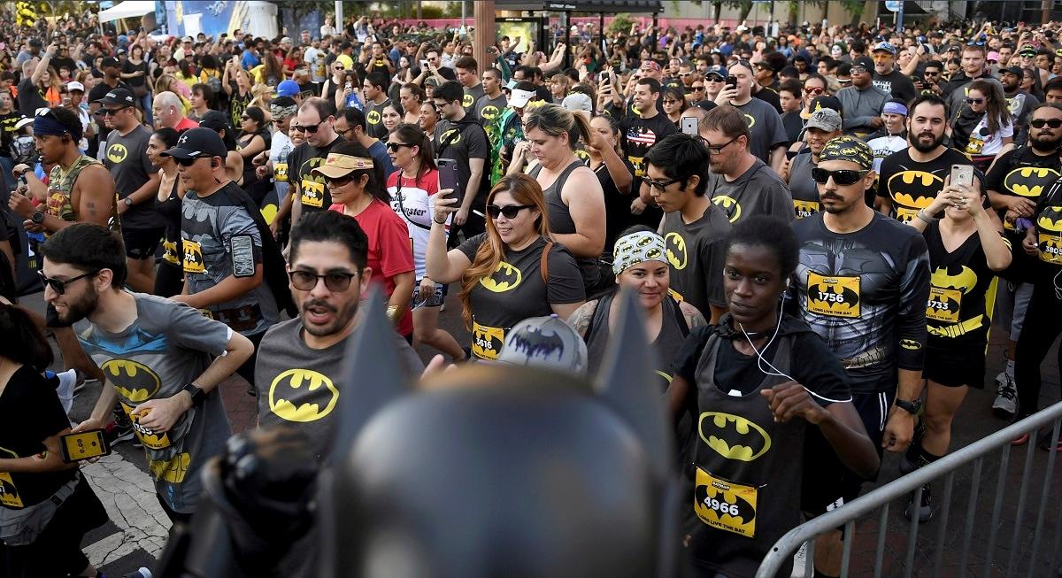 The start of the Batman Inaugural 5K run on Batman's 80th anniversary at Grand Park on Saturday in Los Angeles. (Keith Birmingham/The Orange County Register via AP)