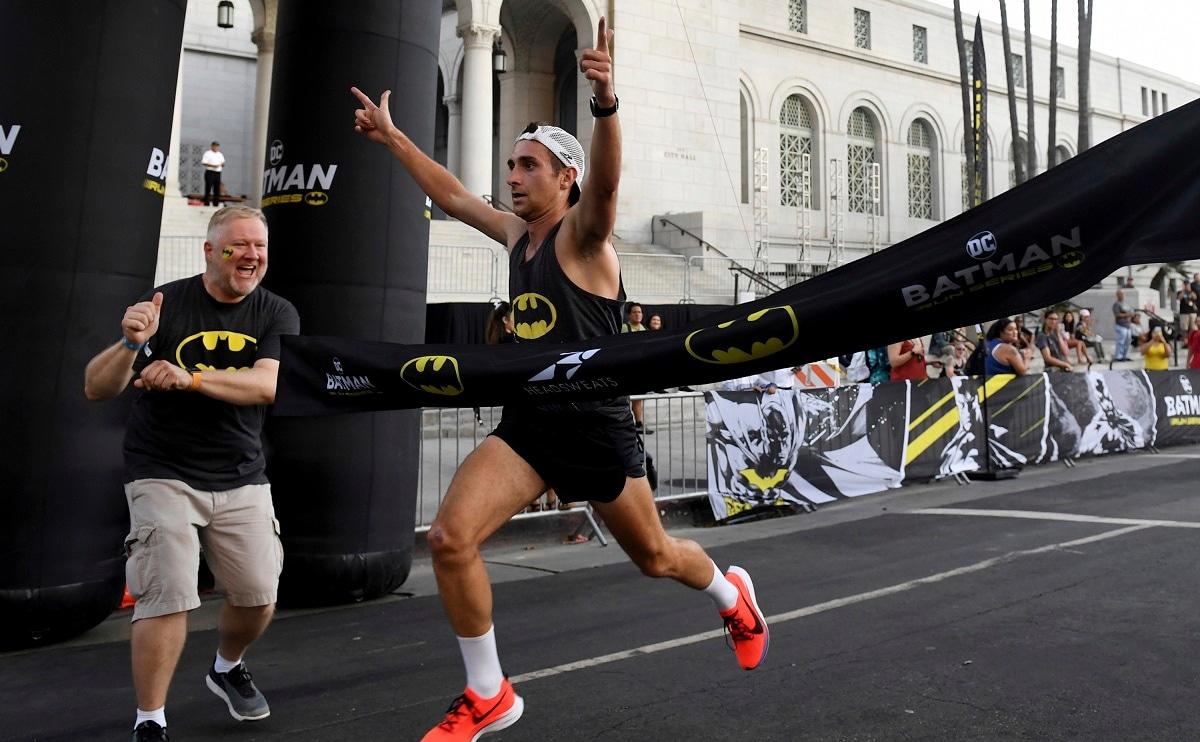 Dan Nestor of Colorado wins the Batman Inaugural 5K run on Batman's 80th anniversary at Grand Park in Los Angeles. (Keith Birmingham/The Orange County Register via AP)