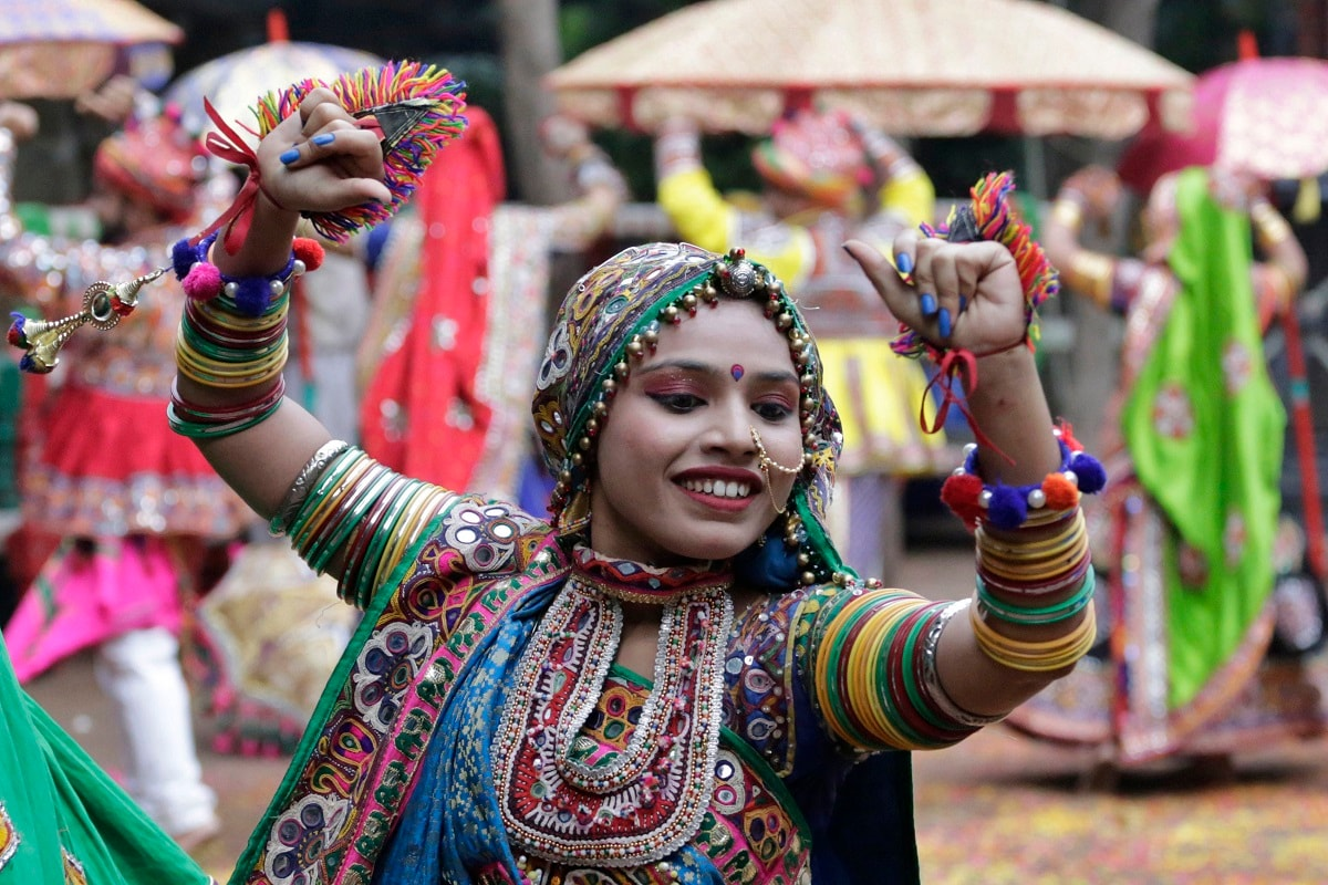 Dancers practice Garba, a traditional dance of Gujarat state, ahead of Hindu festival Navratri in Ahmadabad. The festival of Navratri or nine nights will begin from September 29. (AP Photo/Ajit Solanki)