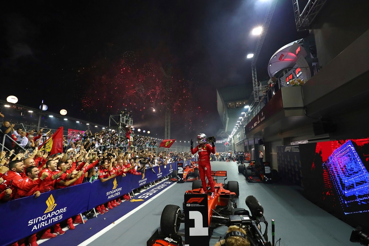 Ferrari driver Sebastian Vettel of Germany celebrates after winning the Singapore Formula One Grand Prix in Singapore. (AP Photo/Lim Yong Teck, File)