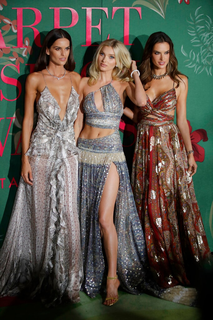 Models Izabel Goulart, from left, Elsa Hosk and Alessandra Ambrosio pose for photographers upon arrival at the Green Carpet Fashion Awards in Milan, Italy, Sunday, Sept. 22, 2019. (AP Photo/Luca Bruno)
