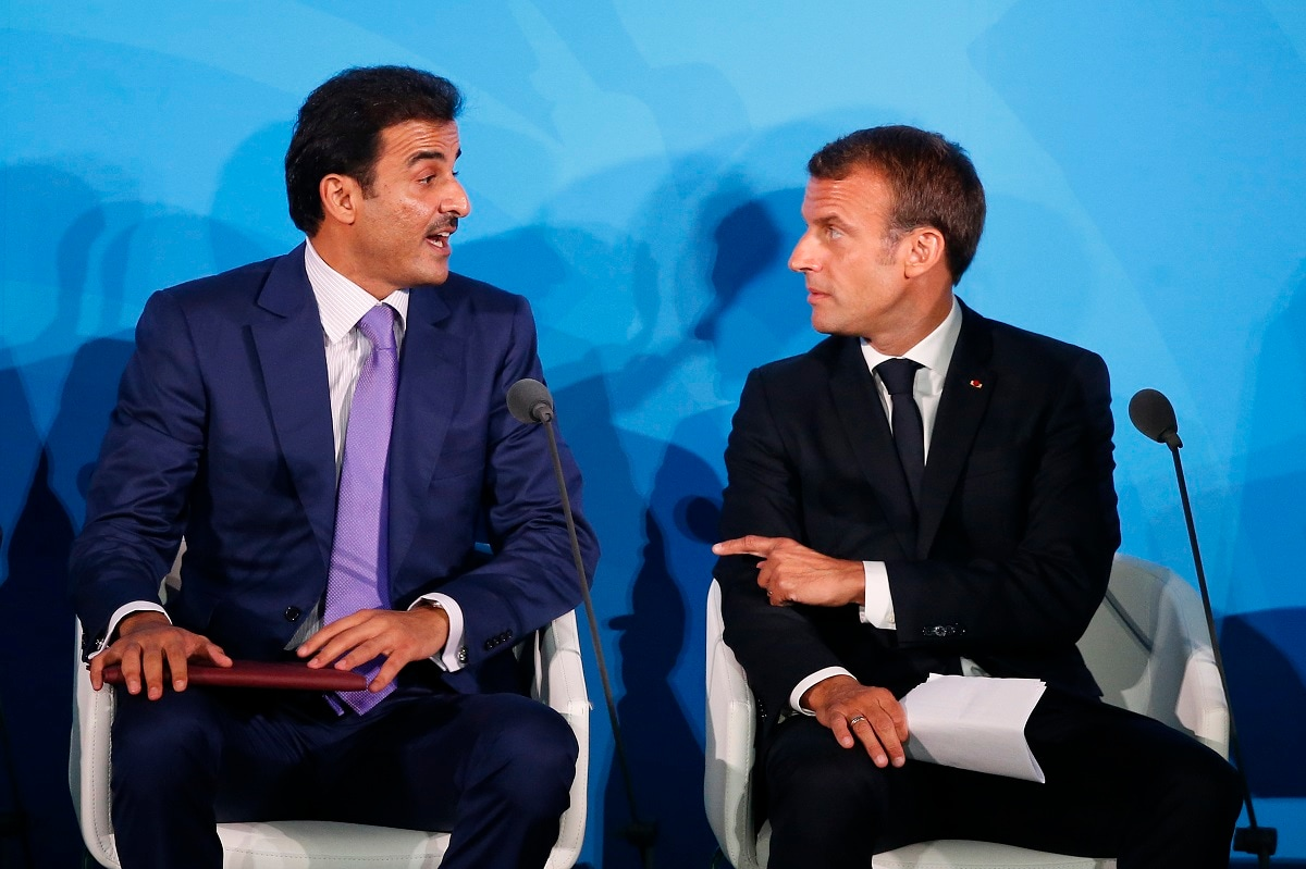 France's President Emmanuel Macron, right, talks with Qatar's Emir Sheikh Tamim bin Hamad Al-Thani before addressing the Climate Action Summit in the United Nations General Assembly, at UN headquarters. (AP Photo/Jason DeCrow)