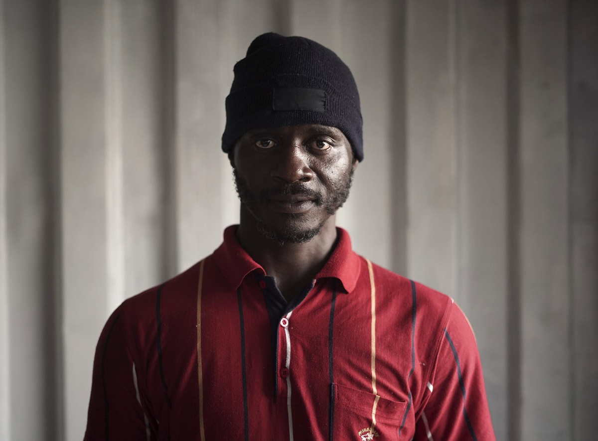 Eclador Ngatcho, 40, from Cameroon, pose for a portrait aboard the humanitarian rescue ship Ocean Viking, in Italian waters off the Sicilian town of Messina, southern Italy, Monday hours before disembarking. Ngatcho used to work as a delivery driver in his home country of Cameroon where his two daughters (one of whom was born after he left) still live with their mother. He left to find a better job to support his growing family and ended up in Libya where he was sent to a detention centre. He was beaten when he couldn't afford to pay the ransom the prison guards asked from him and was forced to work as a cook. He eventually escaped. (AP Photo/Renata Brito)