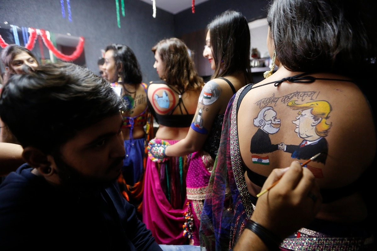 A girl gets a tattoo depicting Prime Minister Narendra Modi and US President Donald Trump done on her back in preparation of Navratri in Ahmedabad. (AP Photo/Ajit Solanki)