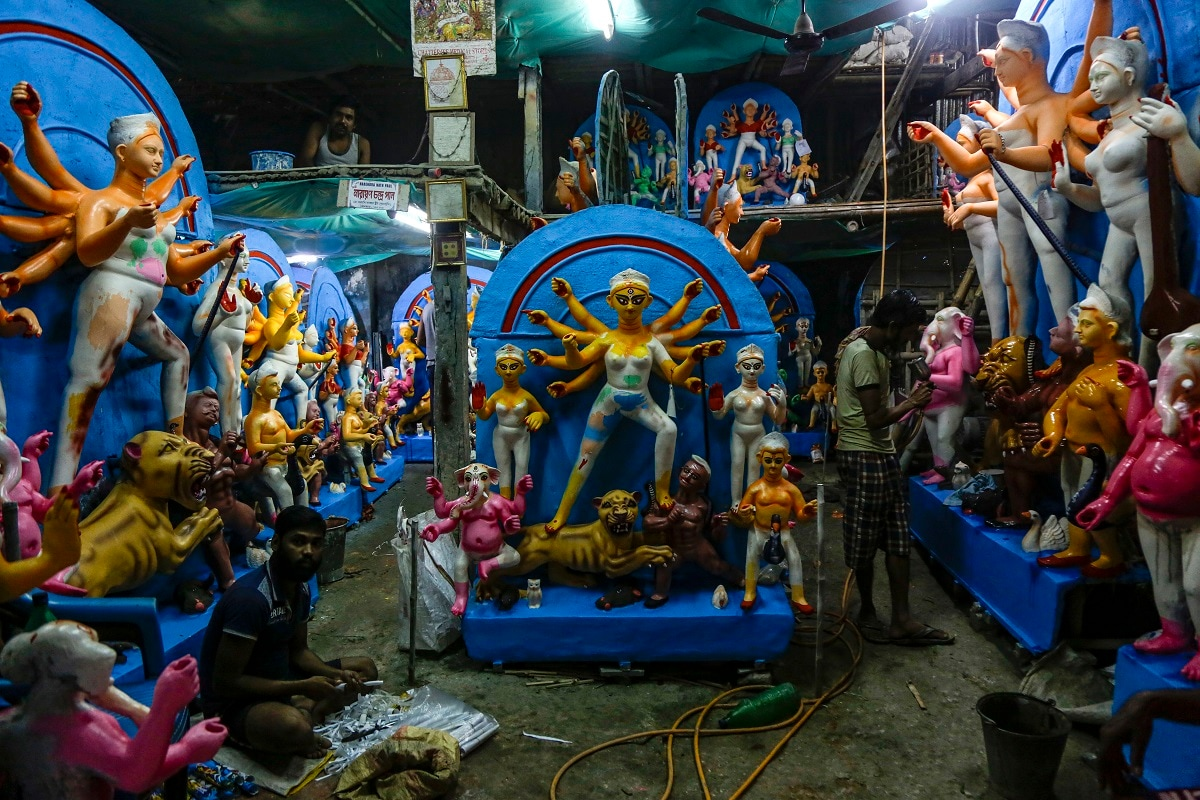 Artisans prepare clay idols of Durga at a makeshift studio in Kolkata. (AP Photo/Bikas Das)