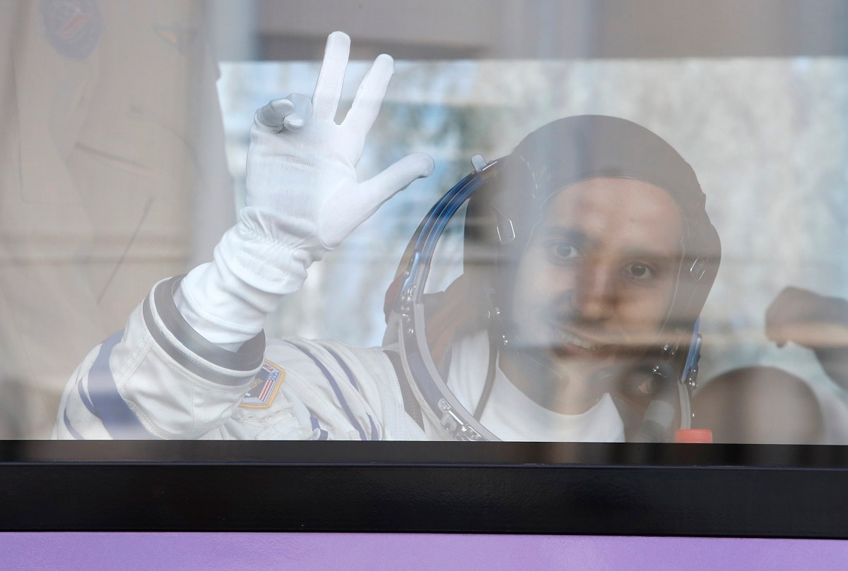 United Arab Emirates astronaut Hazza Almansoori, member of the main crew to the International Space Station (ISS), waves to his relatives. (AP Photo/Dmitri Lovetsky. Pool)